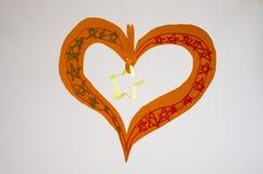 Child heart artifact. Child handmade from papaer heart artifact Royalty Free Stock Photo