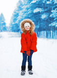 Child with heart in hands outdoors in winter Royalty Free Stock Photo
