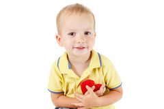 Child with heart symbol isolated white. Concept of love and health. Royalty Free Stock Photos