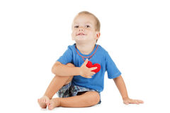 Child with heart symbol  white. Concept of love and health. Royalty Free Stock Photography