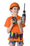 The child in a helmet. The child in an orange helmet with tools on a white background Royalty Free Stock Image