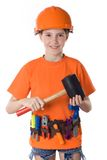 The child in a helmet. The child in an orange helmet with tools on a white background Royalty Free Stock Photos