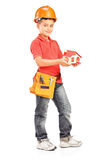 Child with helmet holding a model of house. Full length portrait of a child with helmet holding a model of house  on white background Stock Photo