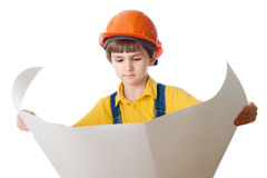 The child in the helmet looks at the drawing. The child in the helmet looks at the expanded drawing, isolated on white Stock Images