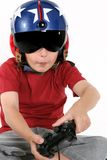Child in helmet playing a flight simulator Royalty Free Stock Photos