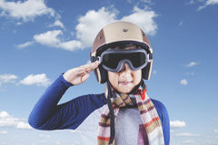 Child with helmet and saluting gesture Royalty Free Stock Photo