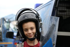 Child with helmet and shield Royalty Free Stock Images