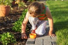 Child helping in garden royalty free stock photos
