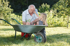 Child is helping her Grandfather Royalty Free Stock Photography