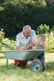 Child is helping her Grandfather Stock Photography