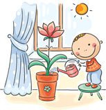 Child helping parents with the housework - watering flowers Stock Photo