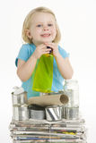 Child Helping With Recycling Stock Photography