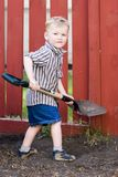 Child helping shovel Stock Photos