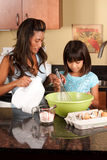 Child helps mom cook Royalty Free Stock Images