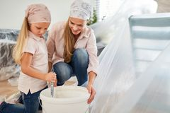 Free Child Helps Mom To Paint And Renovate Stock Image - 139995171