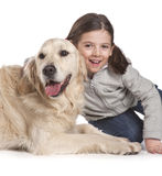 A child with her dog Stock Images