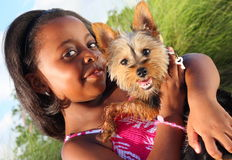 Child With Her Dog. Young girl holding an adorable little yorkie Royalty Free Stock Photo
