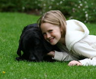 Child with her dog Royalty Free Stock Images
