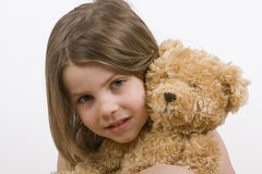 Child and her Teddybear. Shot of a young girl cuddling her teddybear Royalty Free Stock Photos