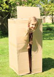 Child hiding in box Royalty Free Stock Photography