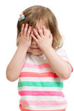 Child hiding face by hands. Isolated on white Stock Photography