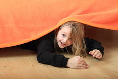 Child hiding under bed Royalty Free Stock Photos