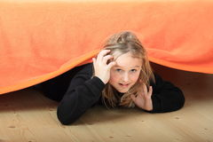 Child hiding under bed Royalty Free Stock Image
