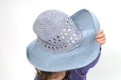 Child hiding under hat Stock Photo