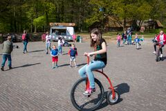 Child on a high wheel bicycle in the open air museum in Arnhem, the Netherlands