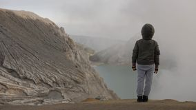 Child hiking on mountain. Foggy, smoky climate