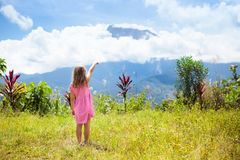 Child hiking in mountains. Kids jungle trekking. royalty free stock images