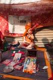 Child Hindu Sadhu, Gangasagar, Kolkata. BABUGHAT, KOLKATA, WEST BENGAL / INDIA - 9TH JANUARY 2013 : A boy Sadhu (Hindu Saint) hiding his face from visitors on Stock Image