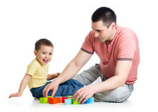 Child and his dad playing game together. Over white background stock photography