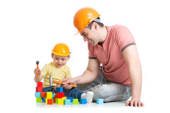 Child and his dad playing game together. Over white background Royalty Free Stock Photo