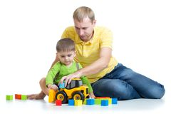 Child and his dad repair toy tractor Royalty Free Stock Image