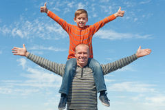 Child and his dad with thumbs up Stock Photography