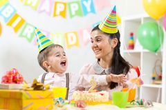 Child and his mom have fun on birthday Royalty Free Stock Photos