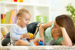 Child and his mom play zoo holding animal toys Stock Photo