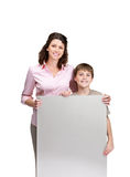Child and his mother holding balnk billboard Stock Photos