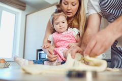 A child with his mother prepares the dough for cookies. royalty free stock images