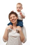 Child on his mother's shoulders Stock Photos