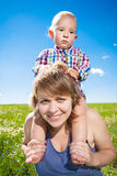 Child and his mother stock images