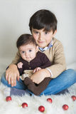 A child with his sister in Christmas Royalty Free Stock Photos