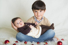 A child with his sister in Christmas Stock Images