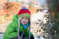 A child with his  winter cap Stock Photo