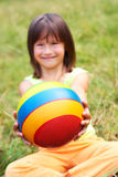 The child hold a ball. Age - 3 years Royalty Free Stock Image