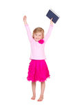 Child hold book above head Royalty Free Stock Image