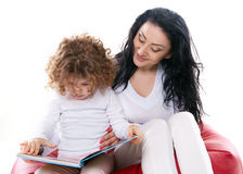 The child hold a book with mother isolated Royalty Free Stock Photography