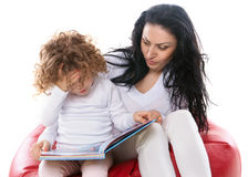 The child hold a book with mother  Stock Photo
