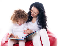 The child hold a book with mother  Stock Images